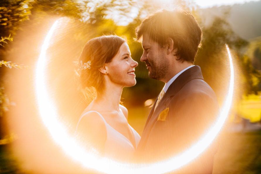 wv backyard minmony couple portrait with flare