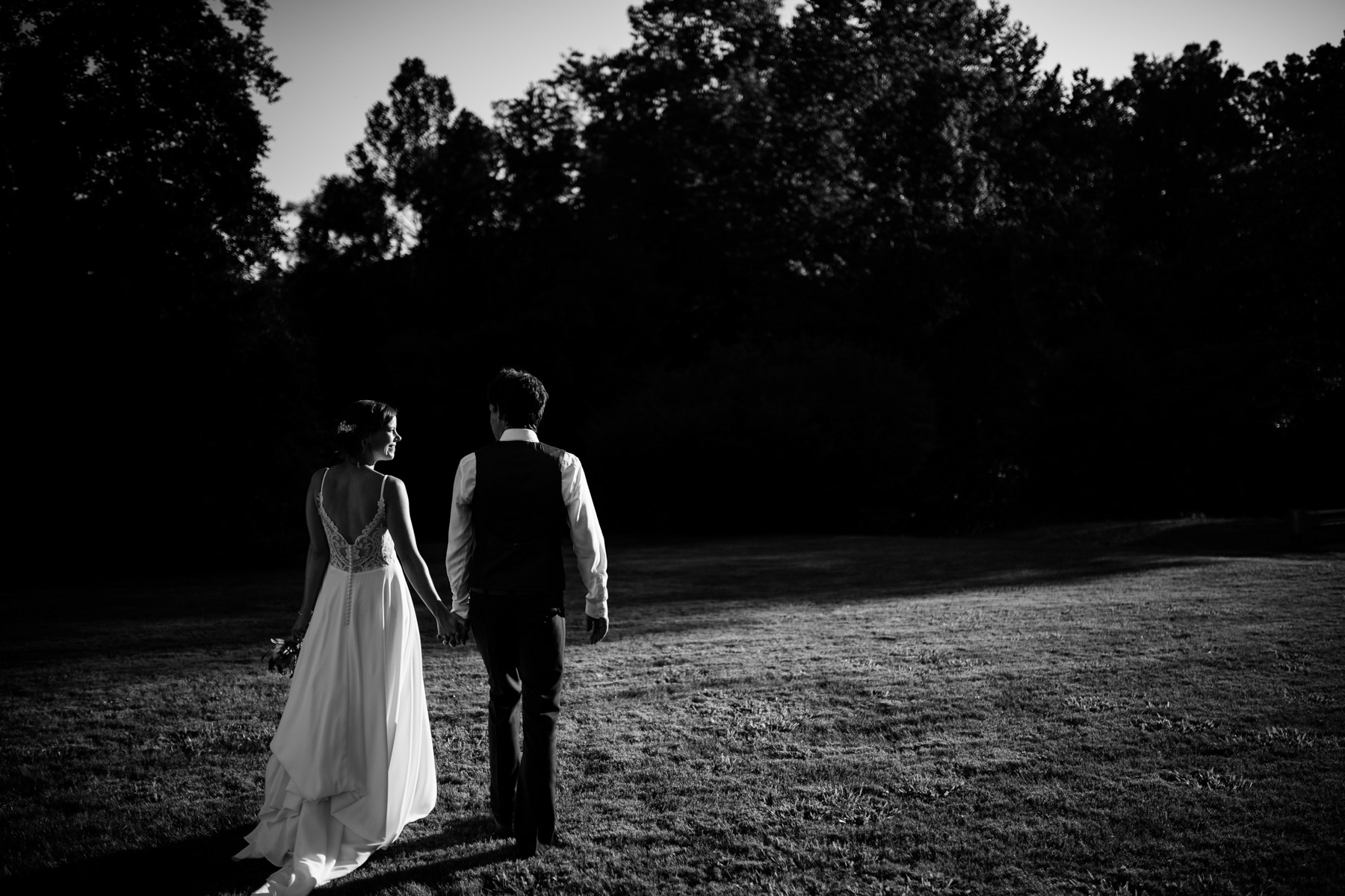 black and white bride and groom walking away