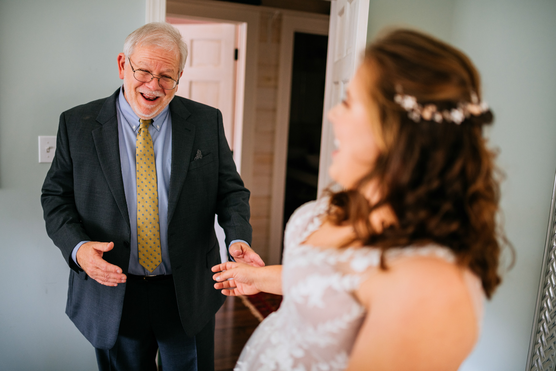 father sees bride in dress