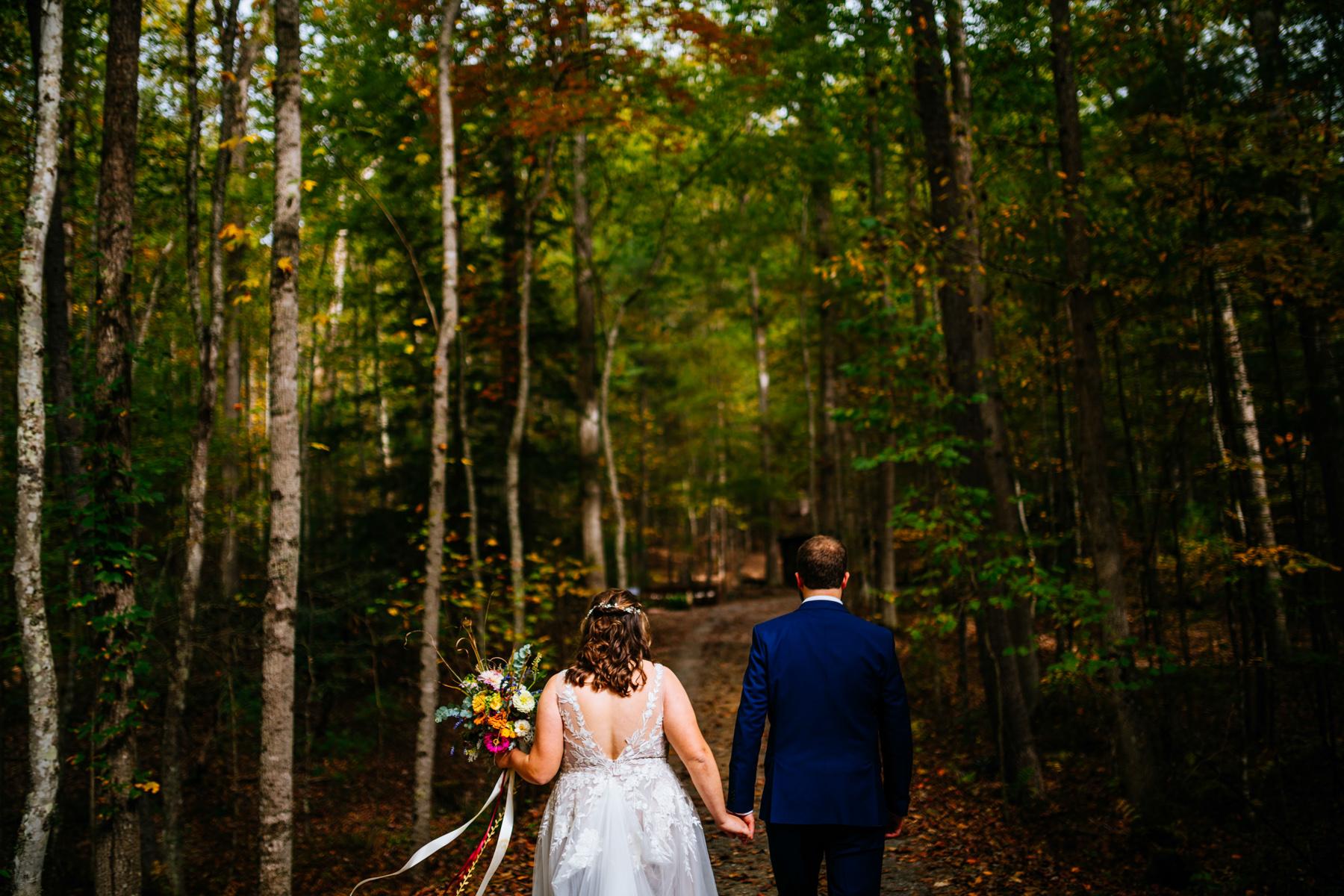 bride groom walking through woods wv micro wedding