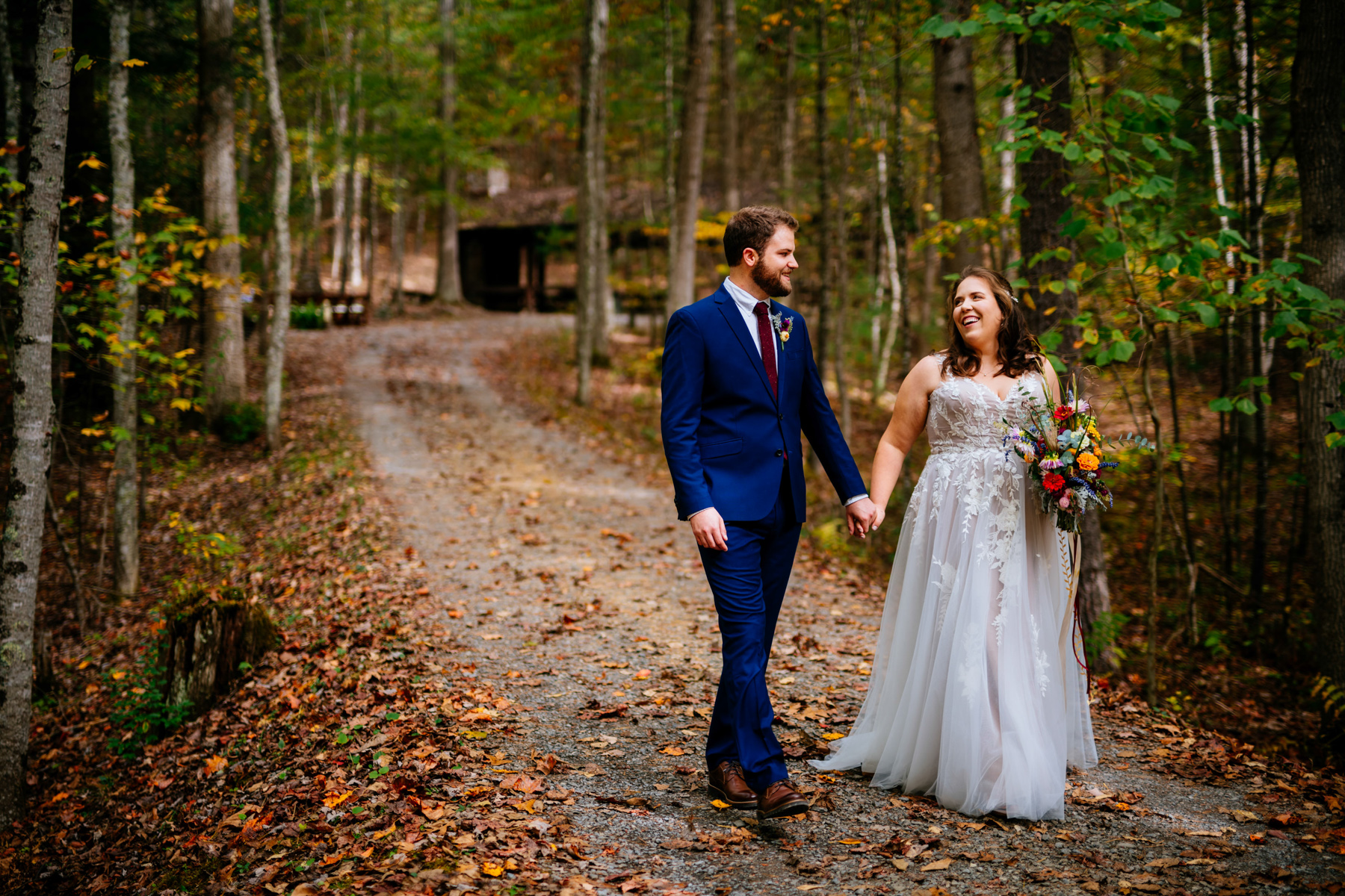 bride and groom walking greenbrier state forest
