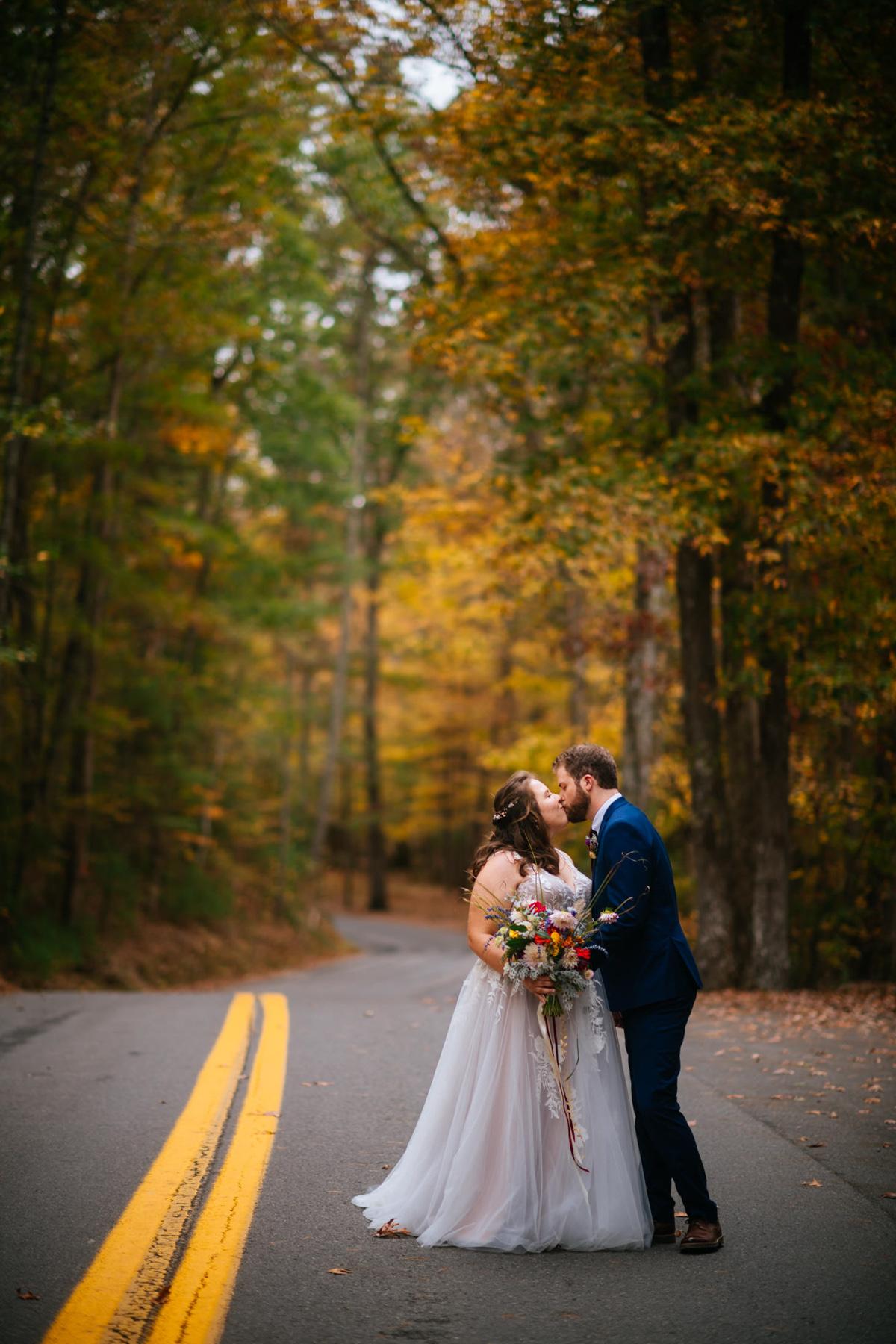 bride groom kissing in road