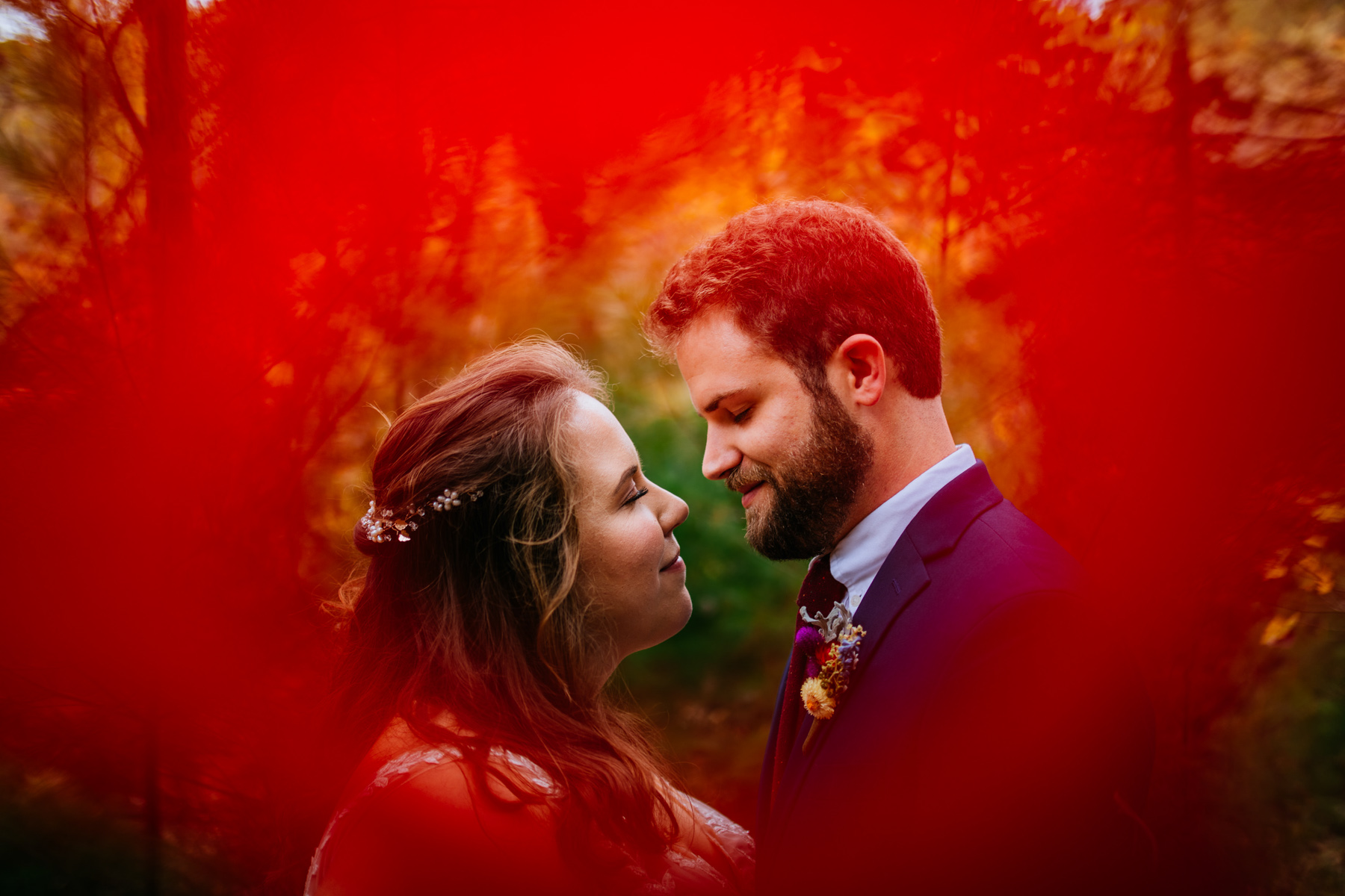 bride and groom surrounded by red