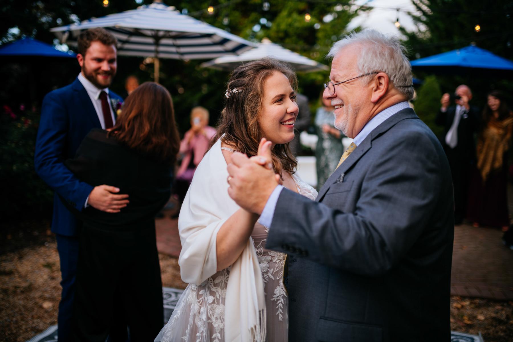 bride dances with dad