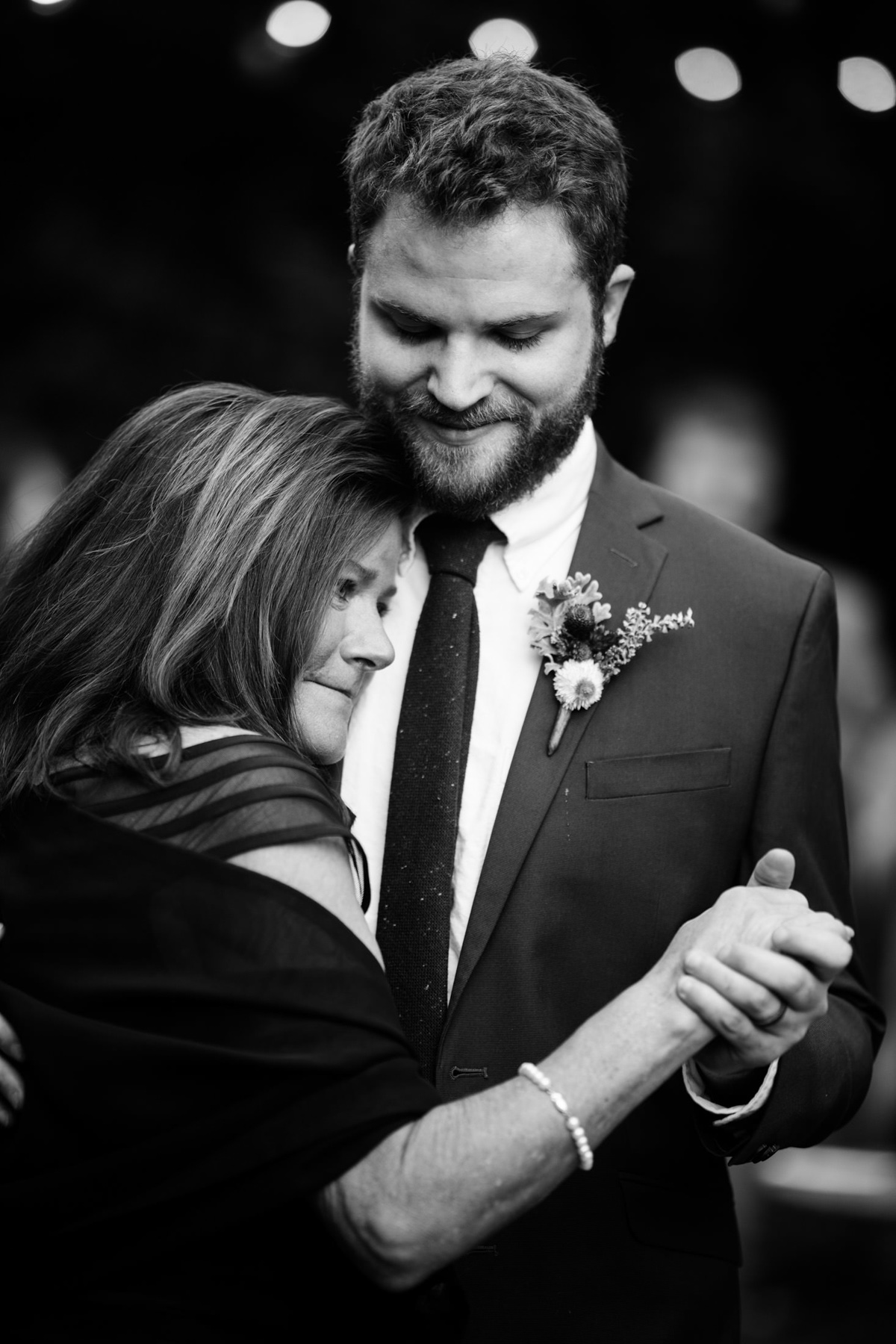 groom dances with mom